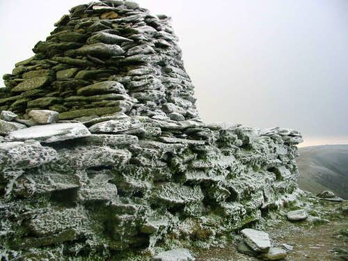 An ice encrusted summit cairn.