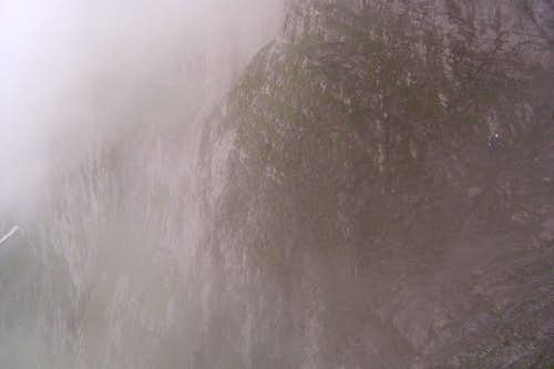 A cliff in the mist. Spot Nigel!