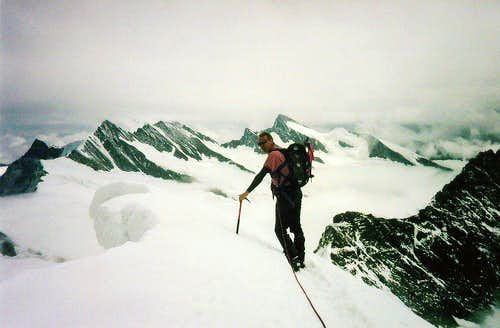 On the summit ridge of the Mönch on a cloudy day (1990). 4099 meters in those days