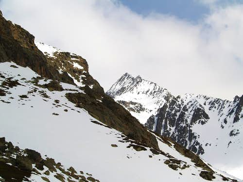 SW side of Monte Cervo <i>(3441m)</i>, seen climbing towards Crete Sèche Hut