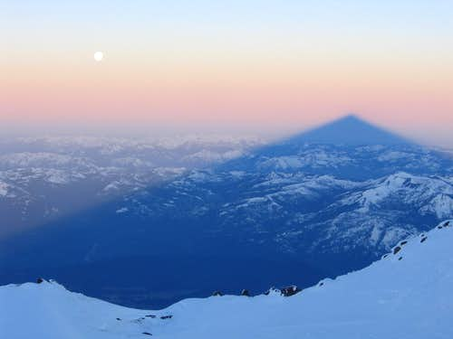 Shasta\'s shadow at sunrise from near 14k (with moon)