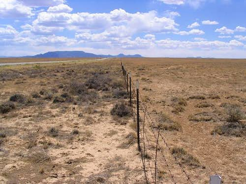A fence line leads right to Roof Butte