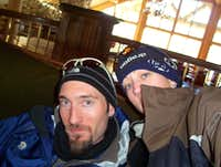 John and I, taking a break from teaching me to snowboard three years ago.