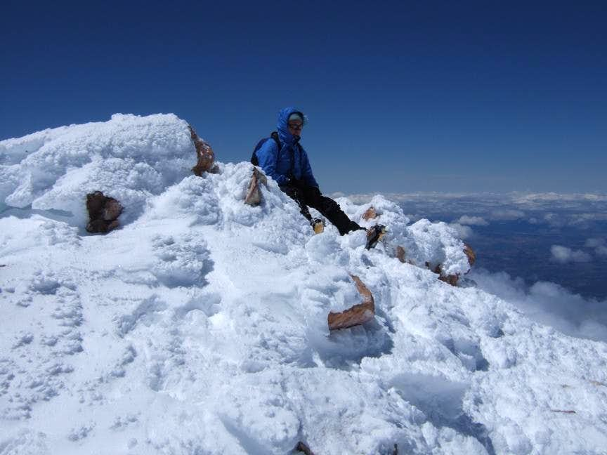 Steph lazing around at the summit of Shasta