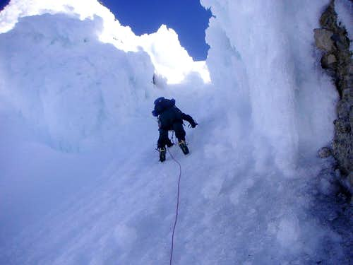 J downclimbing the steep western gully of the Pearly Gates