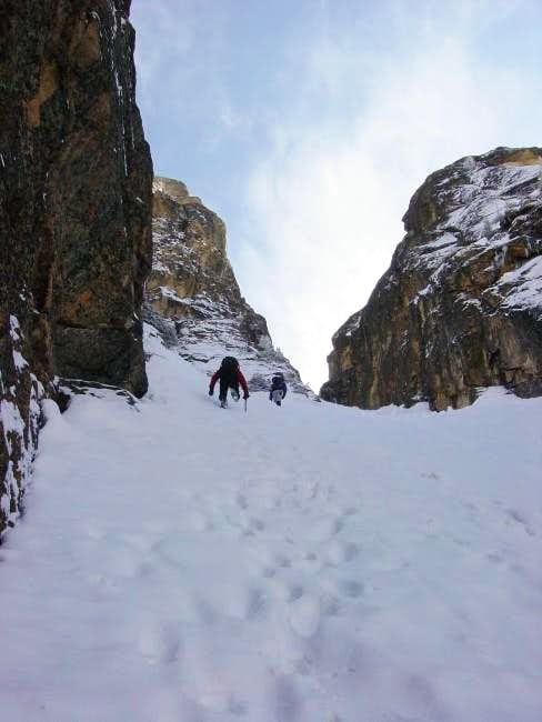 Steep couloir to the base of...