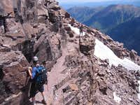 Cliff Traverse on the Northeast Ridge/East Face Route up Pyramid Peak.
