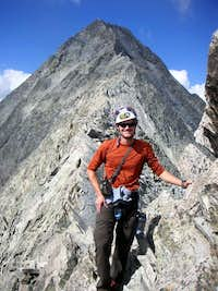 Me, the Knife-Edge, and Capitol Peak after our climb, July 23, 2006.