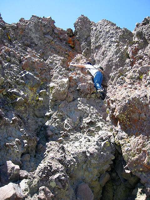 Climbing the summit crag -...