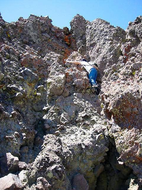 Climbing the summit crag -...