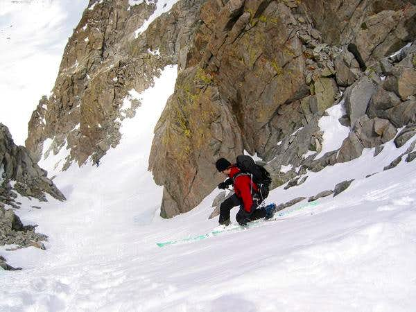 Skiing the U-Notch Couloir,...