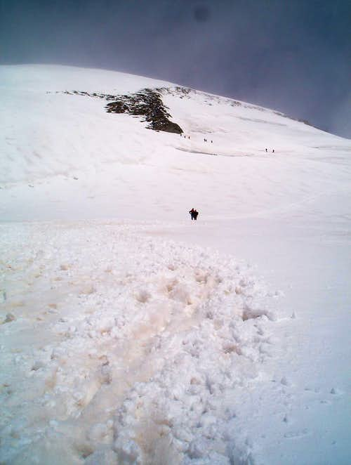 two friend\'s on their way to the summit