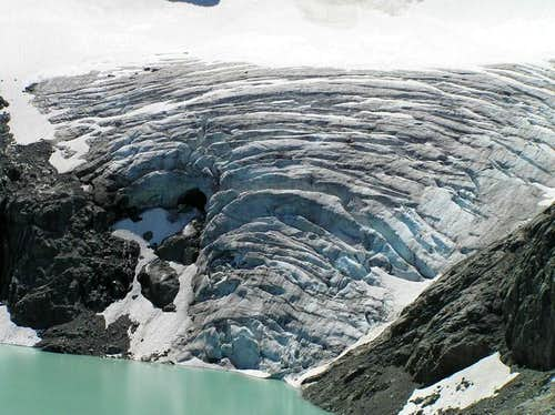 Train glacier spilling into lake