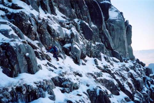 Downclimbing the east face of...