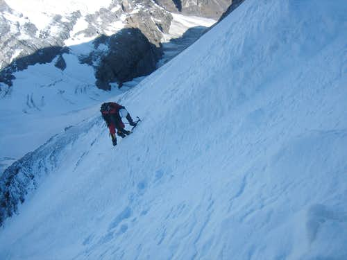 Climbing aside a runnel on the west face of Mt Lefroy