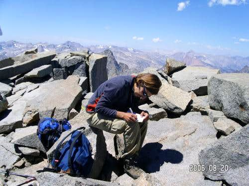 Cenk is signing the summit register