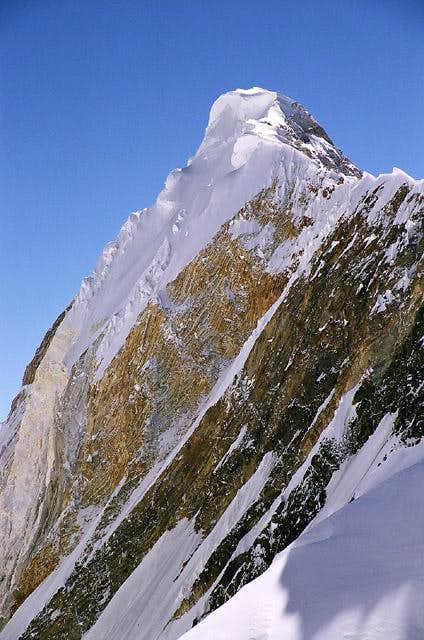 Snow carnice on the neighbouring to Khan Tengri mountain Peak Chapaev makes the Normal route from the South quite risky for climbers