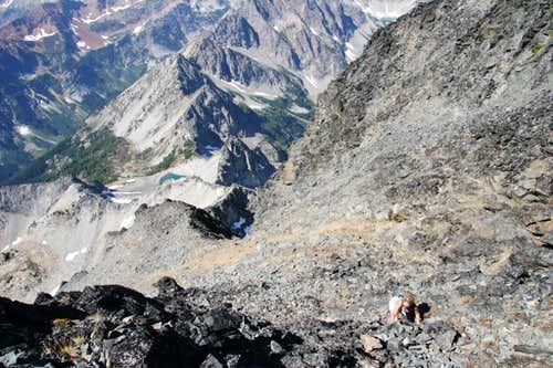jeannie scrambles near the summit of seven fingered jack.