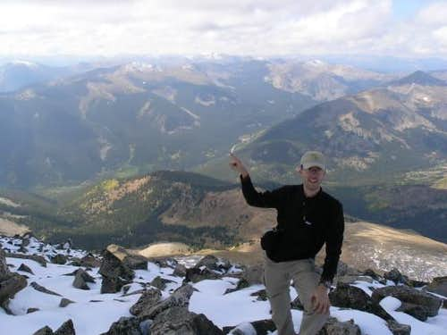 Lonny, pointing to the trailhead on Cottonwood Pass from the summit