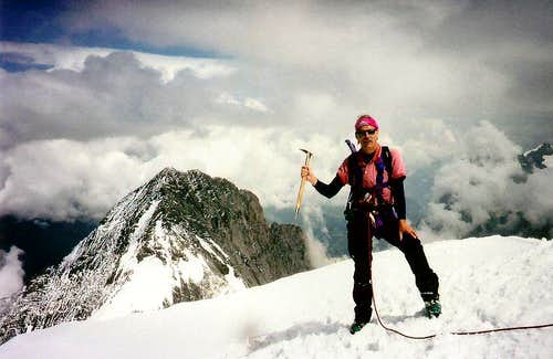 Hans on the summit with Eiger behind