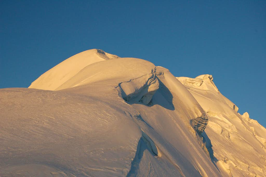 Sunrise over Yazghil Sar's northern ridge