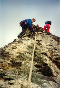 Climbing the first fixed rope on the Mittelegi ridge