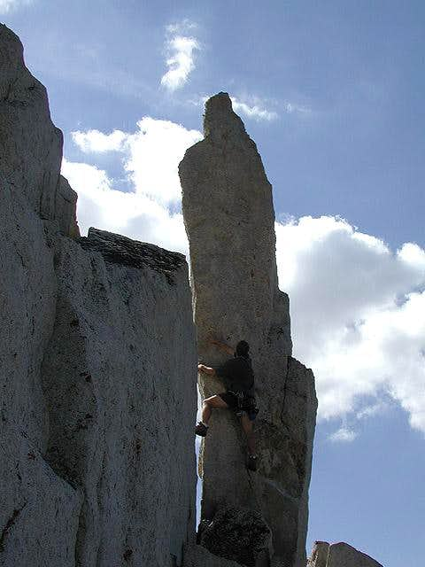 Josh trying out a rock spire...