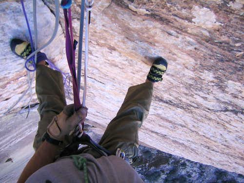 Rappeling down Rainbow Wall