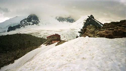 Tracuit hut, Bishorn and  Weisshorn in clouds