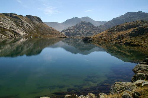 Hoher Schlug (2776m) and Moarer Spitze (2806m), mirrored in one of the lakes of Obere Senner Egete