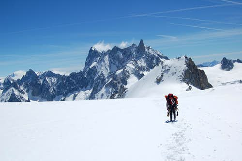 Trekking towards the NE face of Mont Blanc du Tacal with Dent du Géant in the distance