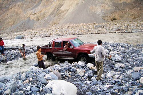 Tricky water crossing on route to Shimshal from Passu