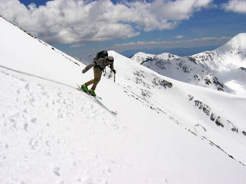 Snowboarding from Mellenthin La Sal Mountains of Utah by Ross Schnell
