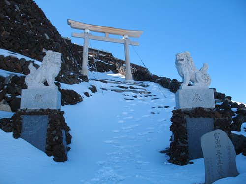 lions and gate just before the edge of the crater