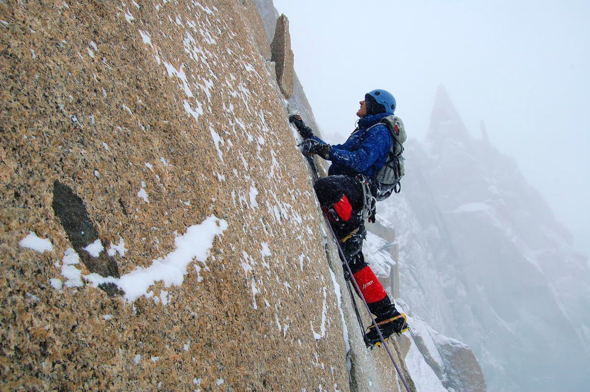 Climbing the aid section on Cosmiques Arête