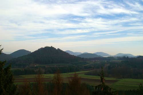 Lindelbrunn Castle and the smooth slopes of the Pfälzerwald mountains