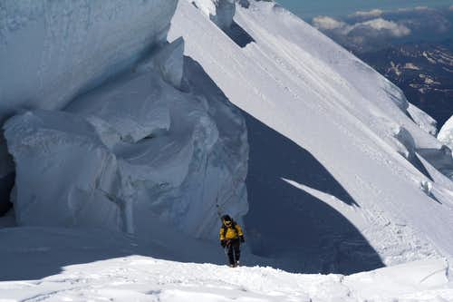 Crossing under huge seracs in the Tacul Northface