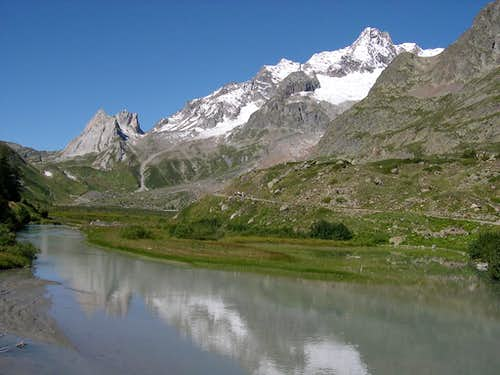 Pyramids Calcaires and Aiguille des Glaciers from the shore of Combal lake