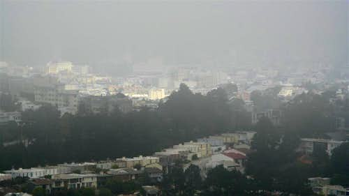 The sun peeking out over Diamond Heights