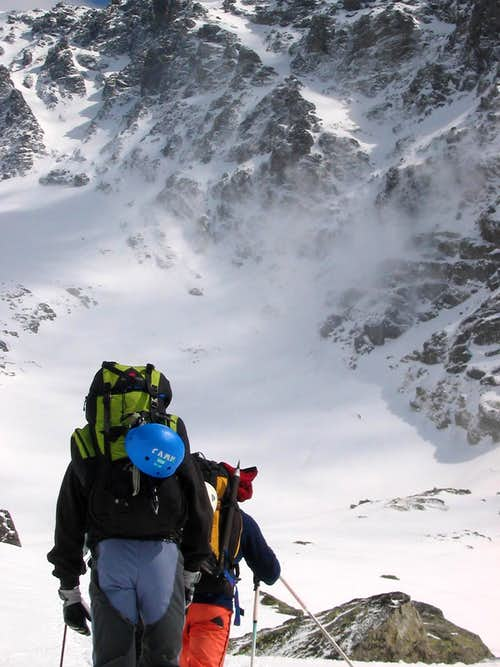 Climbers reaching Rysy in winter conditions