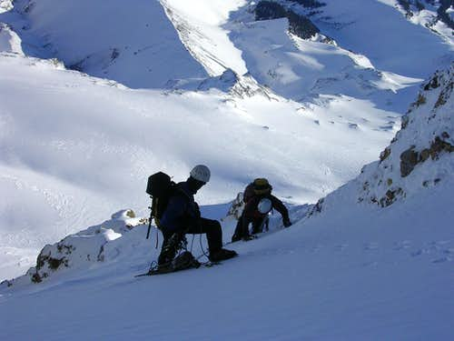 Traverse across the steep snow slope