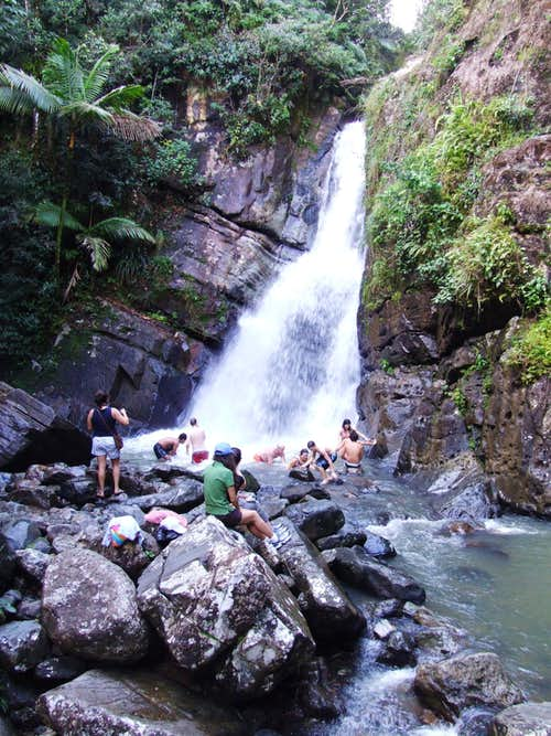 Hikers bathing below La Mina Fall.