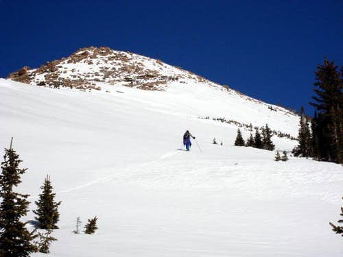 Skiing up the lower South Ridge