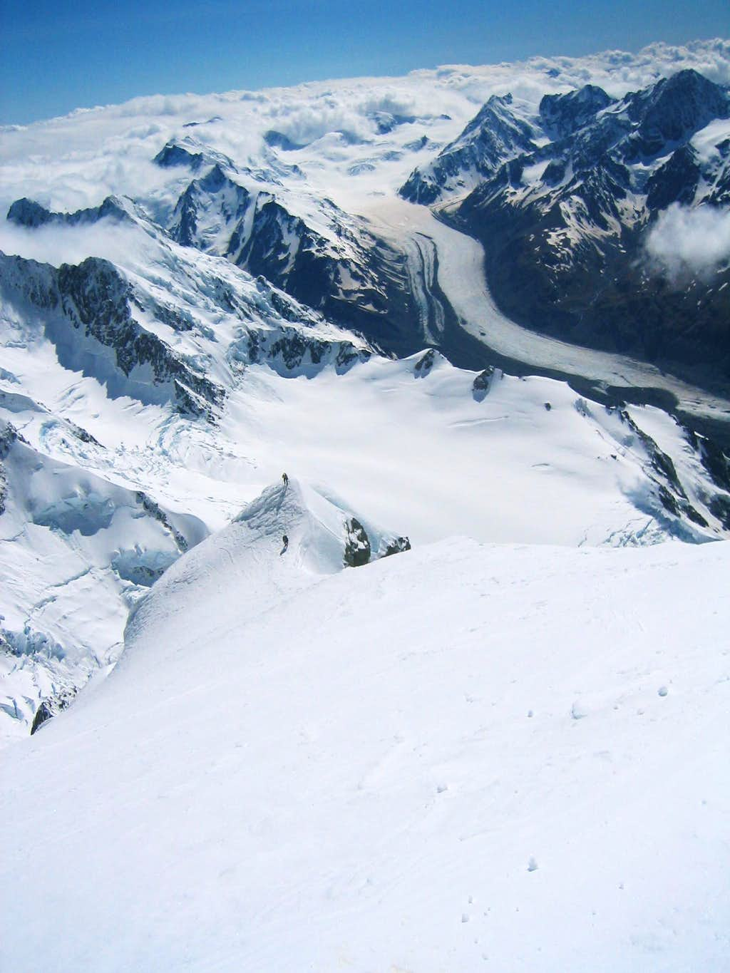 Two climbers below the summit of Mt. Cook