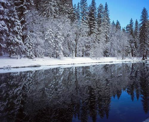 Snowy Merced River Tree Reflection