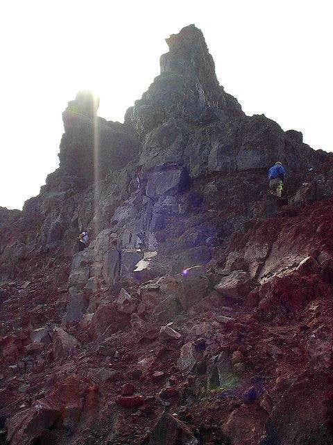 A climber preparing to lead...
