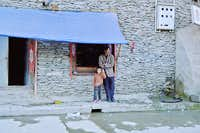 Tibetan boy gives peace sign
