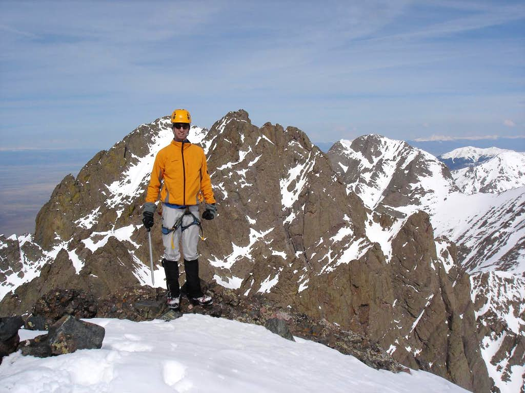 Summit attire. Crestone Peak in back.