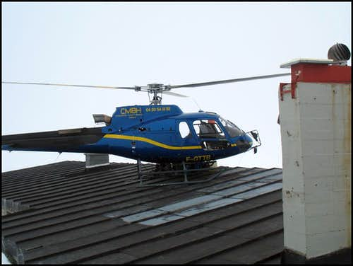 Helicopter landing on the roof.