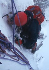 Neil climbing up icy parts of...